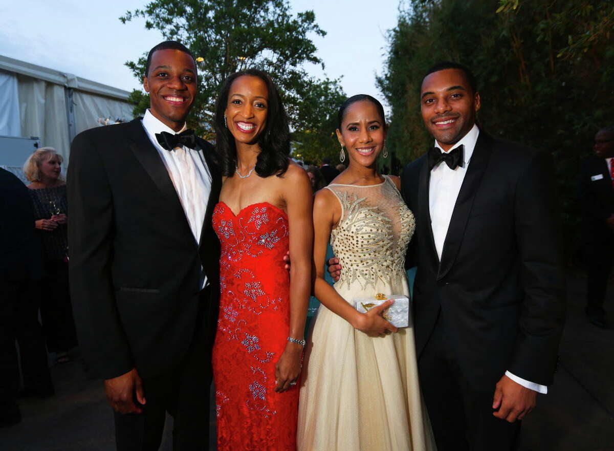 Phil and Andrea Williams and Alexandria Penelton and Christopher Preston at the Zoo Ball on Saturday, April 22, 2017, in Houston. (Annie Mulligan / Freelance)