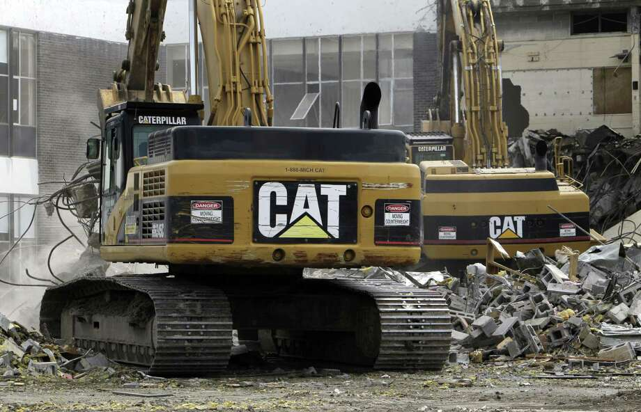 Caterpillar boosted revenue forecasts on Tuesday to a range of $38 billion to $41 billion. First-quarter earnings and sales also topped analysts' expectations. An improving outlook adds to signs that Caterpillar's long-awaited turnaround may be at hand after it cut costs to ride out a slump in demand from the mining and energy industries. Photo: Associated Press File Photo / AP2011