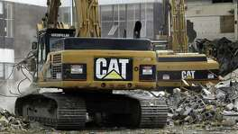 Caterpillar boosted revenue forecasts on Tuesday to a range of $38 billion to $41 billion. First-quarter earnings and sales also topped analysts' expectations. An improving outlook adds to signs that Caterpillar's long-awaited turnaround may be at hand after it cut costs to ride out a slump in demand from the mining and energy industries.