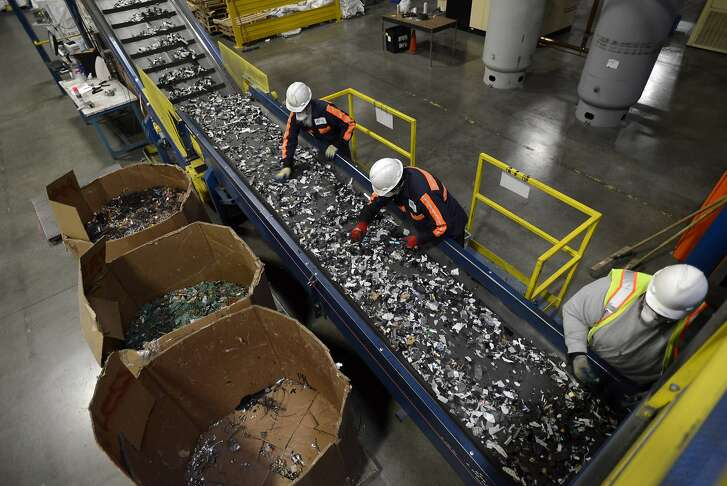 Employees sort through crushed electronic components for recyclable electronic materials at a Sims Recycling Ltd. facility in Roseville, California, U.S., on Friday, Dec. 21 2012. Sims receives much if its material from Green Citizen, a company that collects and disposes old electronics in the San Francisco Bay area. The pieces are put through shredders and broken-down materials are then sold to companies seeking aluminum, plastic, glass or other recycled material. Photographer: David Paul Morris/Bloomberg