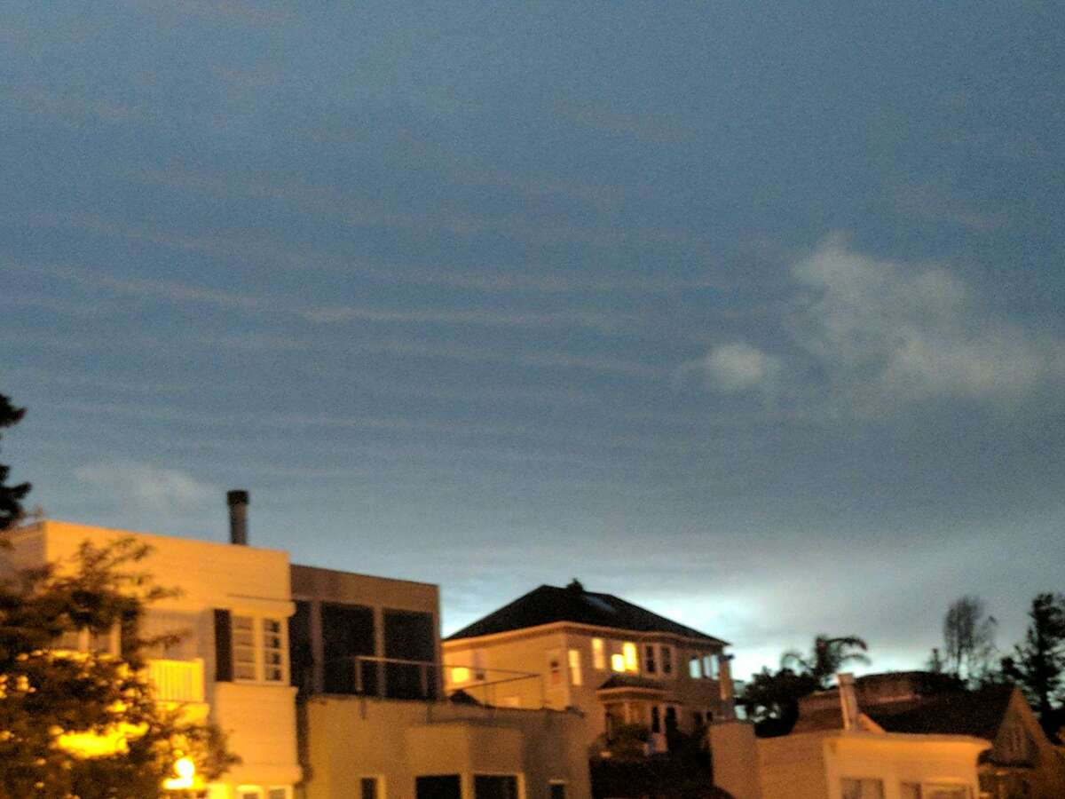 Ripple patterns spread across the San Francisco sky on the evening of Monday, March 24, 2017.