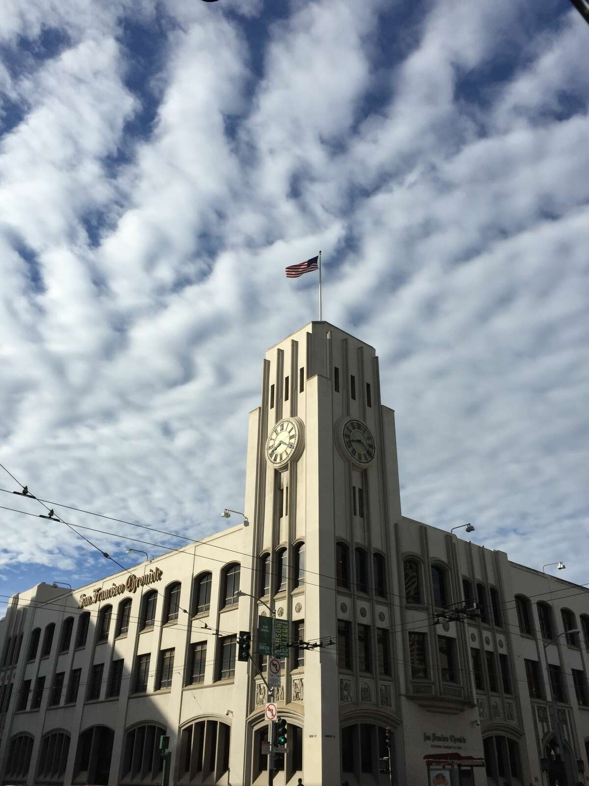 An amalgamation of altostratus and altocumulus clouds in a hypnotizing pattern over the San Francisco Chronicle building at 901 Mission St.