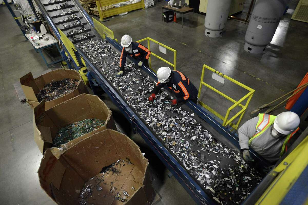 Employees sort through material from recycled electronics at a Sims Recycling facility in Roseville, California. Austin-based Urban Mining Company is proposing to bring a similar facility that will focus on recycling rare earth metal magnets to San Marcos.
