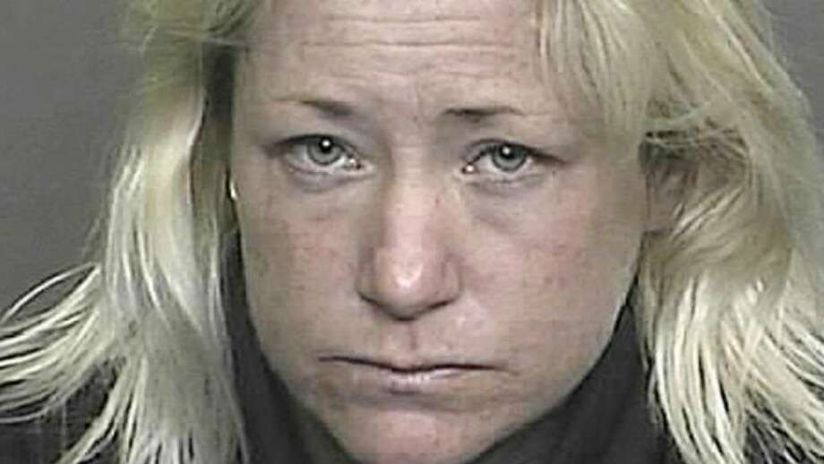 This is a Denver Police photo of Sandra Lee Johnson, 40, who was arrested on suspicion of vehicular homicide, vehicular assault and driving under the influence, after two women were killed in a suspected hit-and-run accident en route to the Denver airport on Wednesday, Jan. 28, 2009, after attending a convention.  Perrot Memorial Library Director Kevin McCarthy told the Greenwich Time the victims were 54-year-old Kathy Krasniewicz and 71-year-old Kate McClelland of Old Greenwich, Conn.(AP Photo/Denver Police) On January 28, 2009, at approximately 10:45am Denver Police were notified of a roll over accident in the area of Pena Blvd and 56th Avenue involving a Freedom Taxi Mini Van.  When Officers arrived they found two female passengers who had been ejected form the vehicle. One of the victims was pronounced dead at the scene the other was transported to University Hospital where she was also pronounced dead.  The taxi driver was transported to Denver Health Medical Center with non life threatening injuries.     Through the investigation and witness accounts it was determined the taxi was struck by another vehicle.  Denver Police, with the assistance of a good witness, quickly located a white pickup truck matching the description of the suspect vehicle, in the Denver International Airport cargo area.  Denver Police were able to locate the driver and passenger of the suspect vehicle.  The suspect has been identified as Sandra Lee Jacobson 01-19-69 and is currently being held for Investigation of two counts of Vehicular Homicide and one count of Vehicular Assault and is suspected of driving under the influence. Photo: ST / Associated Press