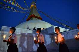 Nepalese school children take part in a candle lighting memorial for the victims of the April 25, 2015 earthquake in Kathmandu on April 25, 2017, as the country marks two year anniversary a deadly earthquake struck the Himalayan nation. More than 700 heritage sites damaged in the disaster which killed nearly 9,000 people and destroyed half a million homes. / AFP PHOTO / PRAKASH MATHEMAPRAKASH MATHEMA/AFP/Getty Images