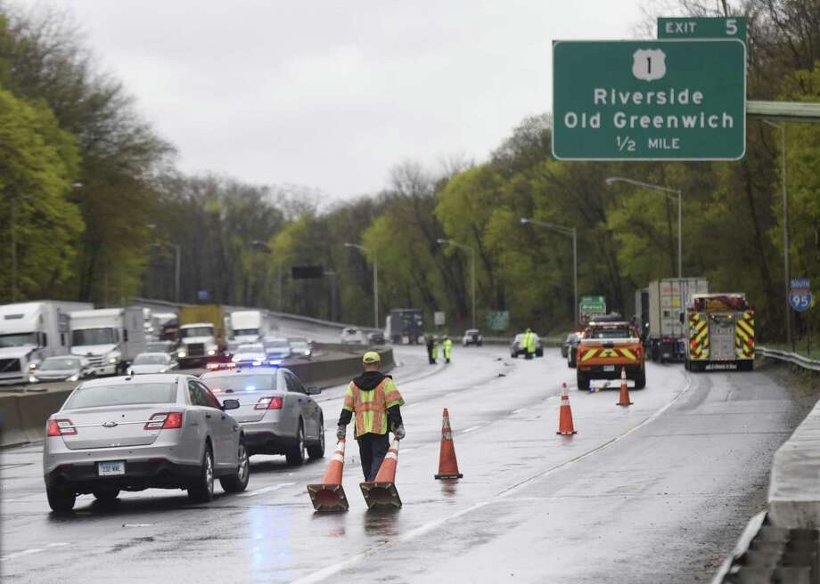 Police and EMS respond to a fatal motor vehicle crash between exits 5 and 6 on southbound I-95 in Greenwich Tuesday. Photo: Tyler Sizemore / Hearst Connecticut Media / Greenwich Time