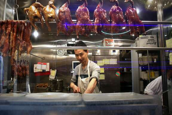 One of the cooks working at the popular New Asia restaurant in Chinatown in San Francisco, Calif., on Tuesday April 26, 2017. The city of San Francisco is in contract to purchase the property and build affordable housing, with a new New Asia restaurant downstairs.