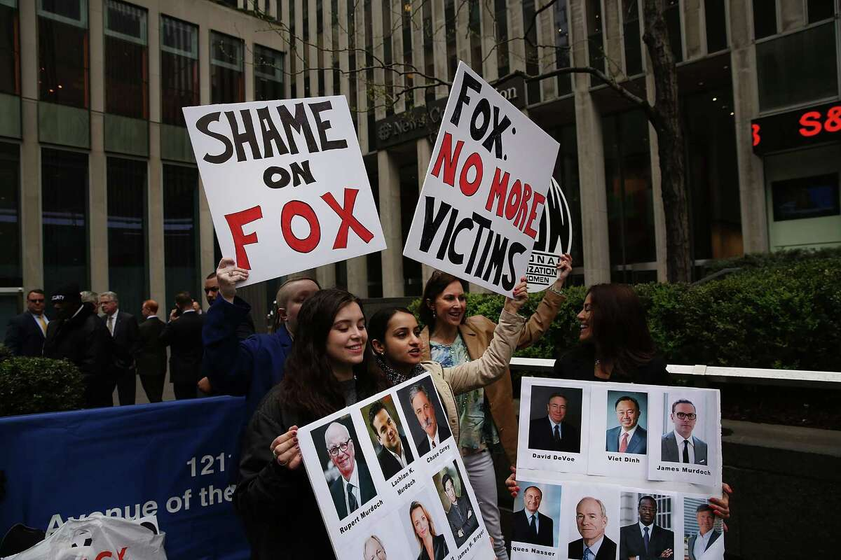 Members of the National Organization of Women (NOW) protest outside Fox News in New York City a day after the network fired host Bill O'Reilly.