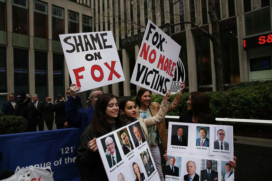 Members of the National Organization of Women (NOW) protest outside Fox News in New York City a day after the network fired host Bill O'Reilly. Photo: Spencer Platt, Getty Images / 2017 Getty Images
