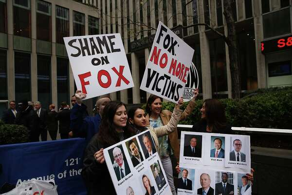 NEW YORK, NY - APRIL 20:  Members of the National Organization of Women (NOW) protest outside of Fox headquarters a day after the popular television network fired host Bill O'Reilly on April 20, 2017 in New York City. O'Reilly was fired following several allegations of sexual harassment against him. The activists believe there is still a rampant culture of sexual harassment at the network.