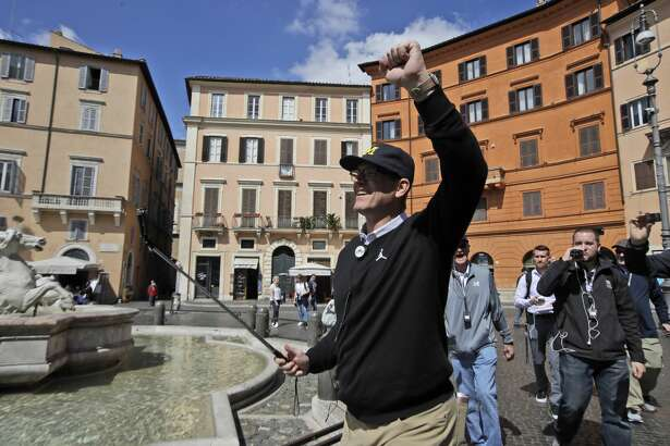 Michigan football team coach Jim Harbaugh, visits Piazza Navona Square in Rome, Monday, April 24, 2017. Michigan's football team arrived in Rome this weekend and kicked off the unique trip by meeting with refugees before going to the Vatican for a Papal address and practicing a few times. (AP Photo/Alessandra Tarantino)