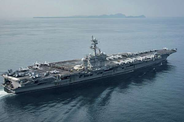 In this Saturday, April 15, 2017, file photo released by the U.S. Navy, the aircraft carrier USS Carl Vinson transits the Sunda Strait between the Indonesian islands of Java and Sumatra. LED tubes made by Stamford-based Revolution Lighting Technologies have been approved for use in Navy vessels.
