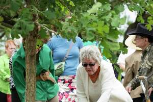 Ann Hamilton, right, helps plant a bur oak tree in honor of environmentalist and philanthropist Terry Hershey at the Eleanor Tinsley Park Tuesday, April 25, 2017, in Houston. Hamilton said she was a close friend of Terry for about 30 years.