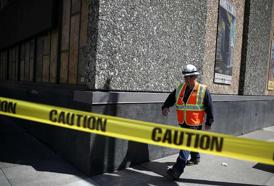 A Pacific Gas & Electric worker walks past an electric substation where a fire occurred and caused a citywide power outage on April 21, 2017 in San Francisco. Photo: Justin Sullivan, Getty Images