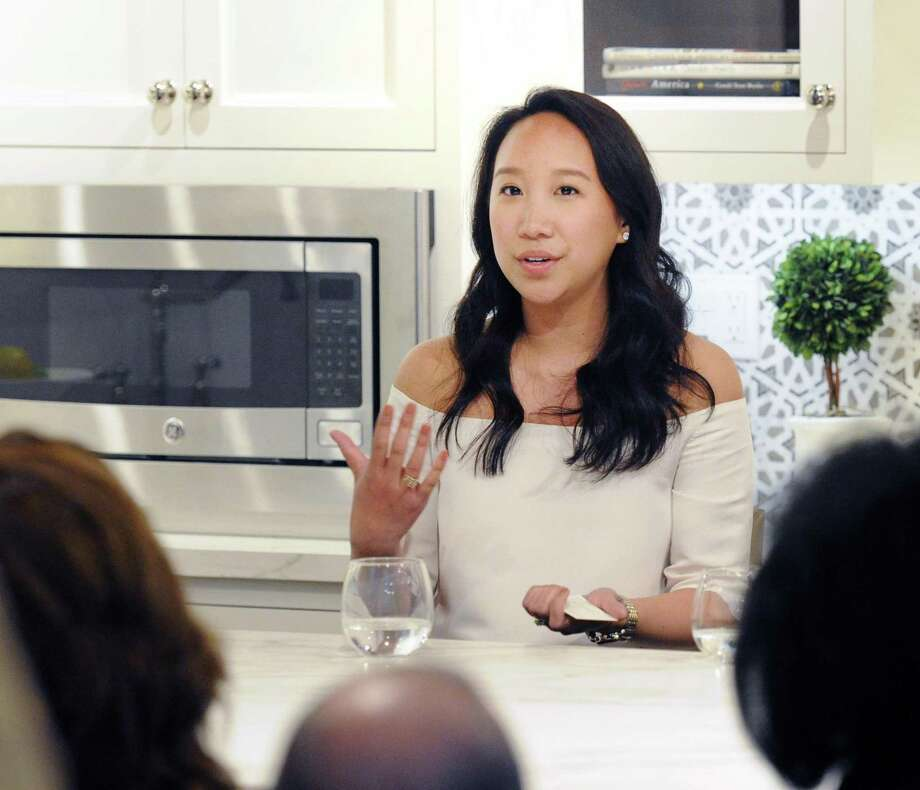 Greenwich resident Katie Fong, a fashion designer and the owner of  the Katie Fong Boutique in Greenwich, speaks during a Luxury Marketing Council  panel event on millennial consumers at Curry &  Kingston Cabinetry in the Cos Cob section of Greenwich, Conn., Wednesday night, April 19, 2017. Photo: Bob Luckey Jr. / Hearst Connecticut Media / Greenwich Time