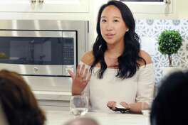 Greenwich resident Katie Fong, a fashion designer and the owner of  the Katie Fong Boutique in Greenwich, speaks during a Luxury Marketing Council  panel event on millennial consumers at Curry &  Kingston Cabinetry in the Cos Cob section of Greenwich, Conn., Wednesday night, April 19, 2017.