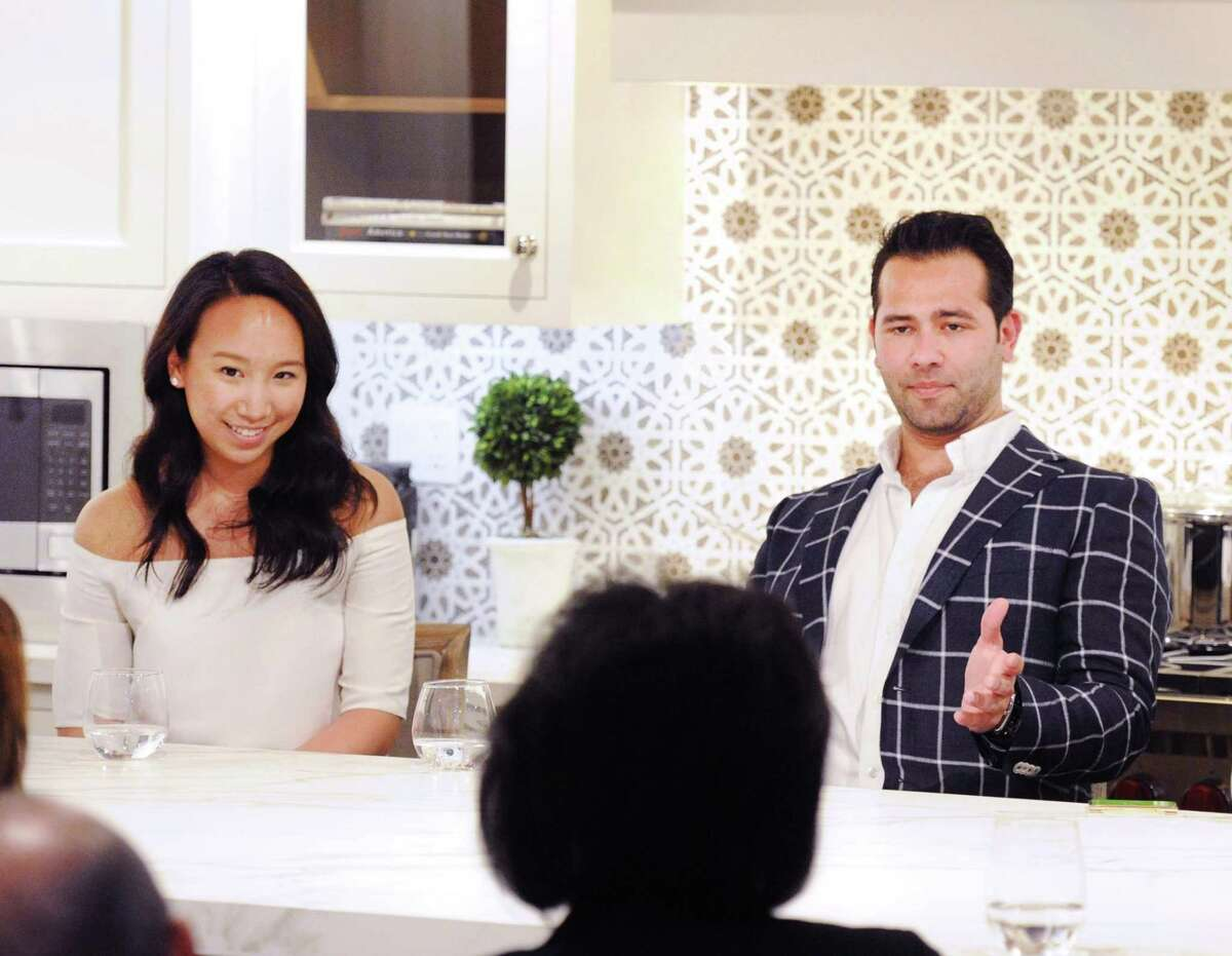 At right, Greenwich resident and entrepreneur Tony Galazin speaks during a Luxury Marketing Council panel event on millennial consumers at Curry & Kingston Cabinetry in the Cos Cob section of Greenwich, Conn., Wednesday night, April 19, 2017. At left is Greenwich resident and fashion designer Katie Fong.