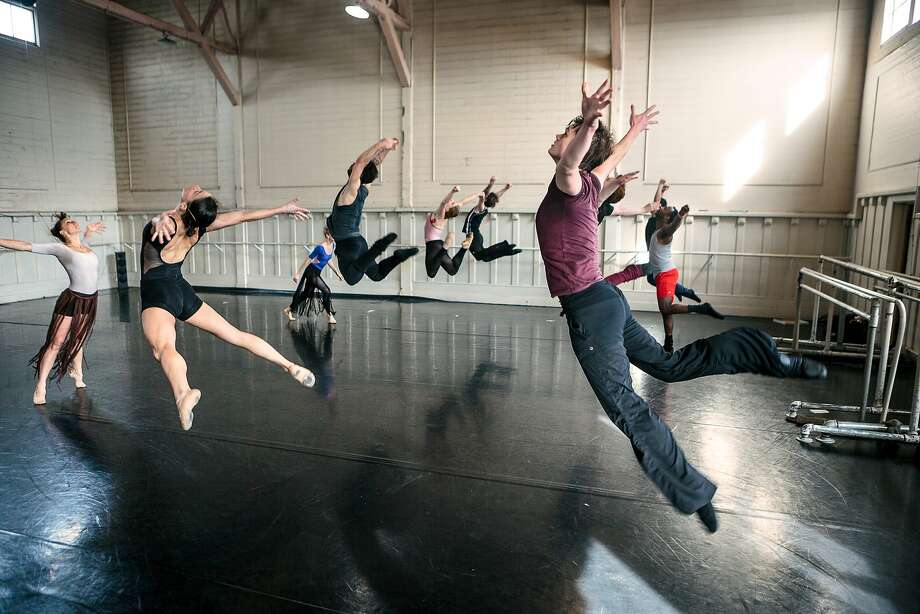 """Smuin dancers leap in a rehearsal of """"Be Here Now,"""" a world premiere tribute to the Summer of Love. Photo: Chris Hardy"""
