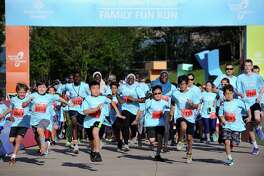 Participants take off at the start line at the fifth annual Family Fun Run