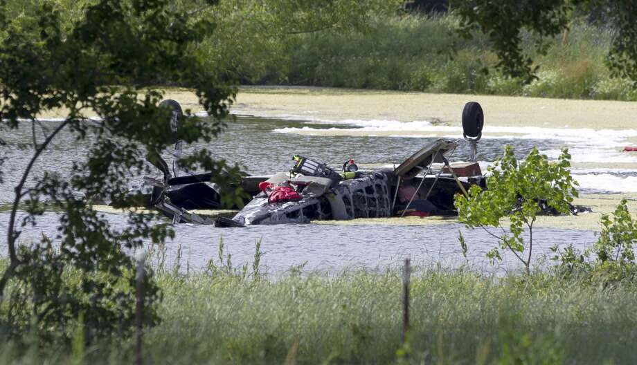 A diver works the scene of a plane crash in a pond near FM 980, Tuesday, April 25, 2017, in Huntsville. The plane took off from Conroe/North Houston Regional Airport and crashed just north of Huntsville around 10:40 a.m. Photo: Jason Fochtman/Houston Chronicle