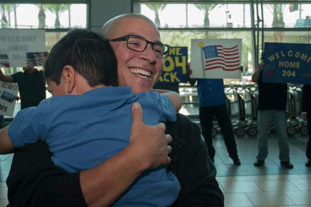 Chief Gunner's Mate Adan Macias, assigned to Littoral Combat Ship (LCS) Crew 204, embraces his son during a homecoming celebration at San Diego International Airport. LCS Crew 204 deployed in June 2016 aboard USS Coronado (LCS 4) for the ship's maiden overseas deployment in support of operations with regional navies in the 7th Fleet Area of Responsibility.