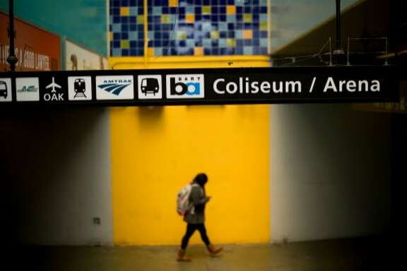 A woman leaves the Coliseum BART station on Tuesday, April 25, 2017, in Oakland, Calif.