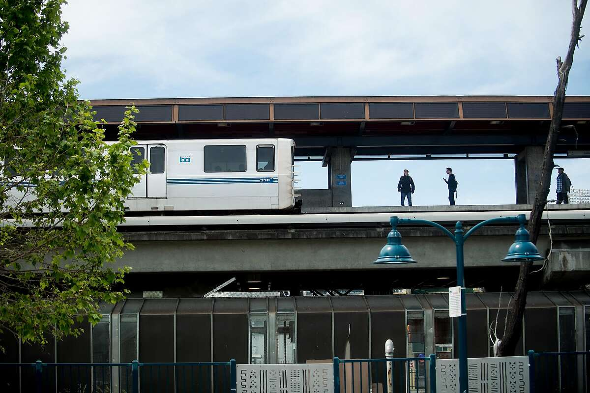 Riders wait for a train at the Coliseum BART Station on April 25 in Oakland.