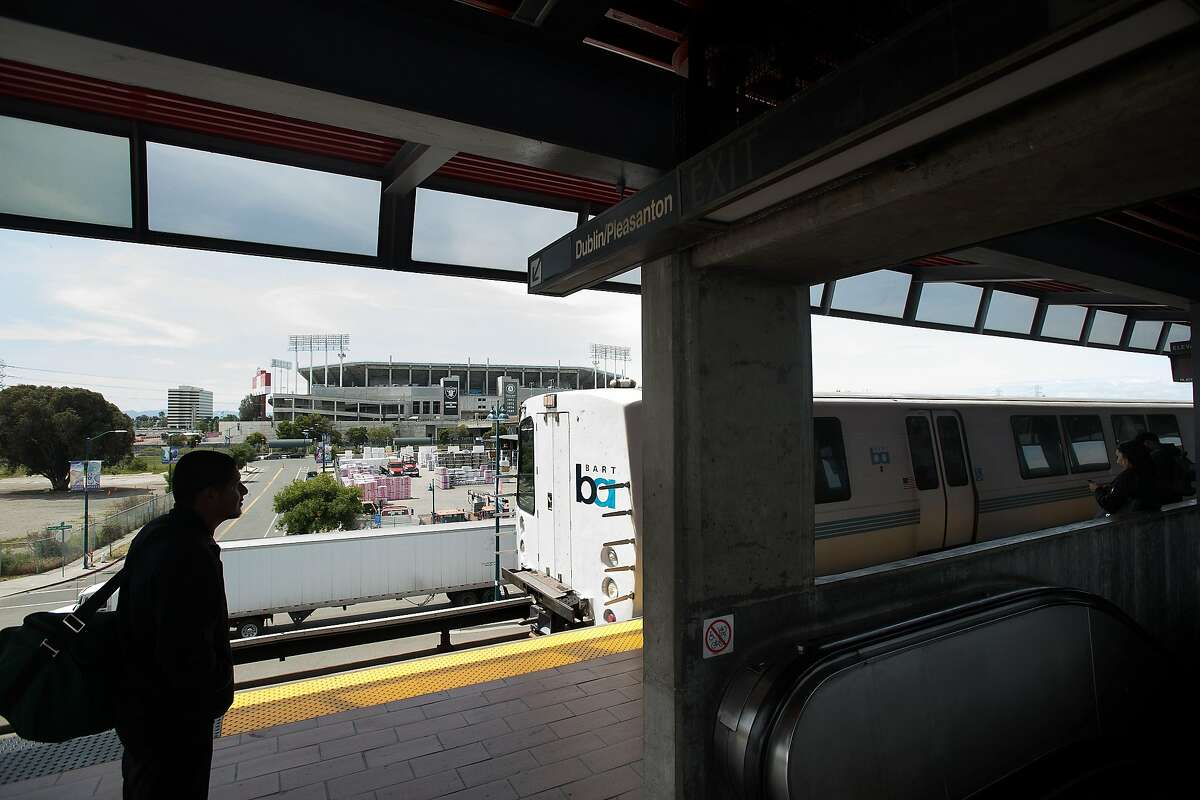 A rider waits for a train at the Coliseum BART station on Tuesday, April 25, 2017, in Oakland, Calif.
