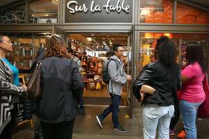 InstaCart operations manager Carson Lee (middle) greets InstaCart shoppers about to be trained in shopping at Sur la table, a non-grocery store specializing  in kitchen supply on Monday, April 24, 2017, in San Francisco, Calif.