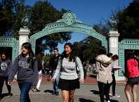 Students walk past  Sather Gate into Sproul Plaza on the Cal campus in Berkeley, CA, Tuesday, March 11, 2014.   State legislature is considering restoring the ability of California universities to use race and ethnicity in admissions decisions.