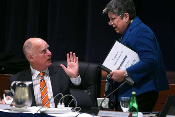 Gov. Jerry Brown waves to UC President Janet Napolitano after Brown arrived to attend the University of California Board of Regents meeting at the UCSF Mission Bay campus in San Francisco, Calif. on Wednesday, March 18, 2015.