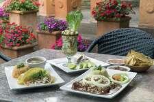 Shrimp tacos, left, ceviche and chicken mole enchiladas from Paloma Blanca.