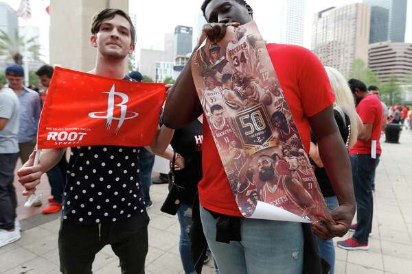 Fans wait to get into the Toyota Center before the start of Game 5 of a Western Conference quarterfinals of the 2017 NBA playoffs, April 24, 2017, in Houston.