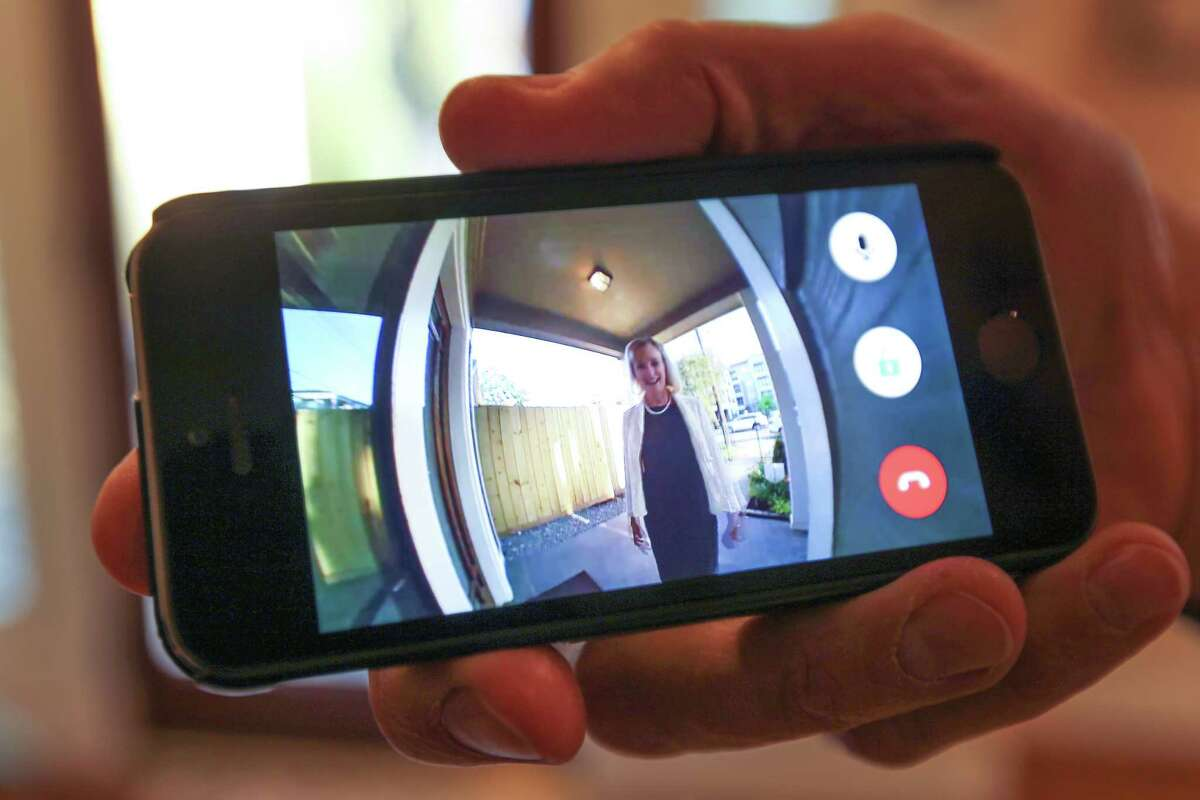 A Reliant executive shows how his smartphone can show who's at the front door.
