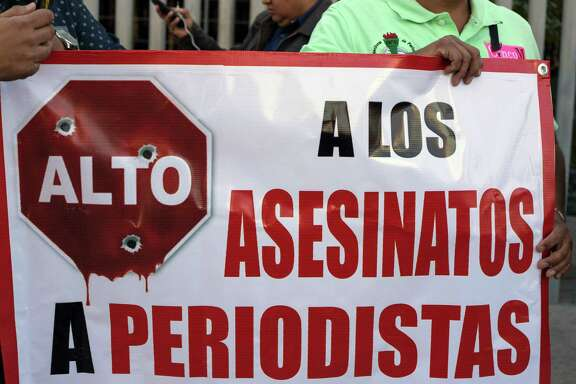 Journalists hold a banner during a demonstration against violence targeting reporters outside the Attorney General of the Republic (PGR) building last month in Tijuana, northwestern Mexico. (Guillermo Arias/AFP/Getty Images)