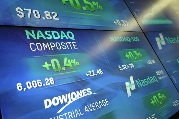 Electronic screens display stock index values at the Nasdaq MarketSite, Tuesday, April 25, 2017, in New York. The Nasdaq Composite rose above 6,000 Tuesday, a record high. (AP Photo/Mark Lennihan)