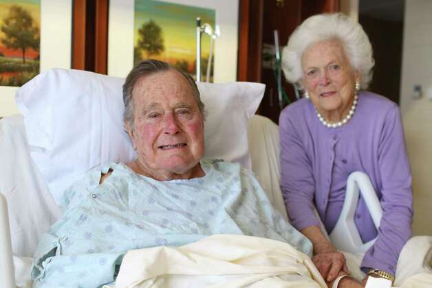 In this photo provided by Office of George H.W. Bush on Monday Jan. 23, 2017, former President George H.W. Bush and his wife Barbara pose for a photo at Houston Methodist Hospital in Houston. The 92-year-old former president is still suffering from pneumonia, but is well enough to leave the intensive care unit at a Houston hospital, doctors said Monday. His wife, Barbara, has been discharged from the same facility after completing treatment for bronchitis. (Courtesy the Office of George H.W. Bush via AP) Photo: Associated Press / Office of George H.W. Bush