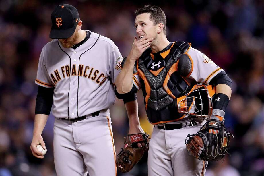 DENVER, CO - APRIL 22: Pitcher Neil Ramirez #59 of the San Francisco Giants confers with catcher Buster Posey #28 in the eighth inning against the Colorado Rockies at Coors Field on April 22, 2017 in Denver, Colorado.  (Photo by Matthew Stockman/Getty Images) Photo: Matthew Stockman / Getty Images / 2017 Getty Images