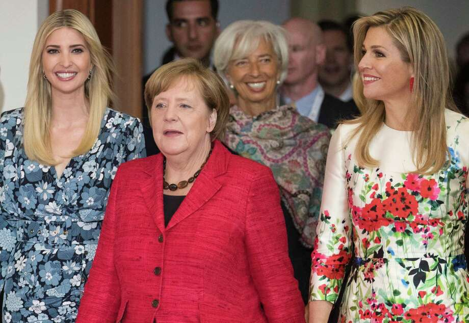 Ivanka Trump, daughter and adviser of U.S. President Donald Trump, left, arrives with Queen Maxima of the Netherlands, right, German Chancellor Angela Merkel, center, and Christine Lagarde, Managing Director of the International Monetary Fund, at the Woman 20 Dialogue summit for the empowerment of women in Berlin, Germany, Tuesday, April 25, 2017. (Michael Kappeler/dpa via AP) Photo: Michael Kappeler, SUB / dpa