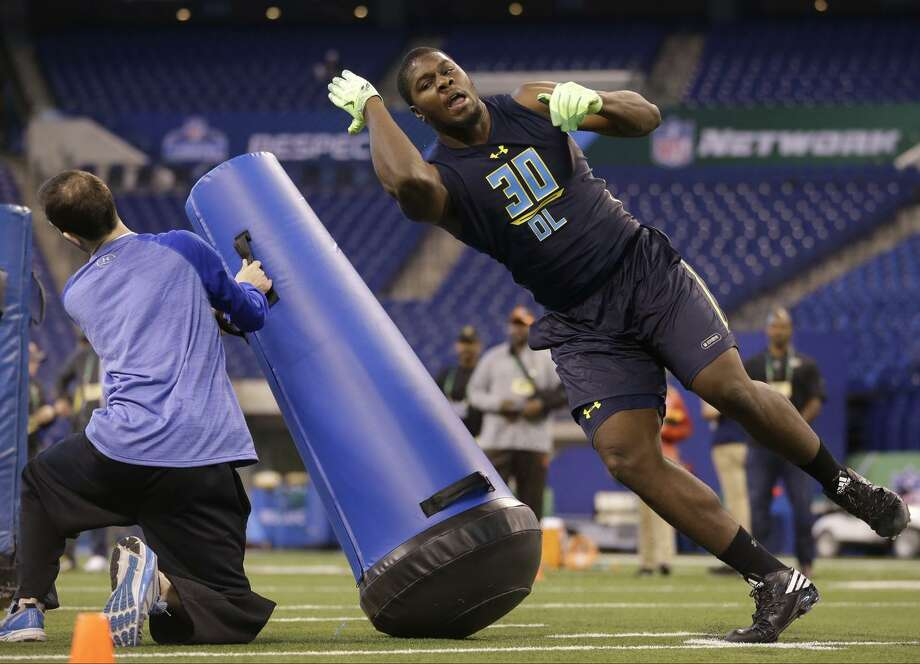 Michigan State defensive end Malik McDowell runs a drill last month at the NFL combine in Indianapolis. While McDowell is physically gifted, scouts question his motor and desire. Photo: Michael Conroy / AP / Copyright 2017 The Associated Press. All rights reserved.