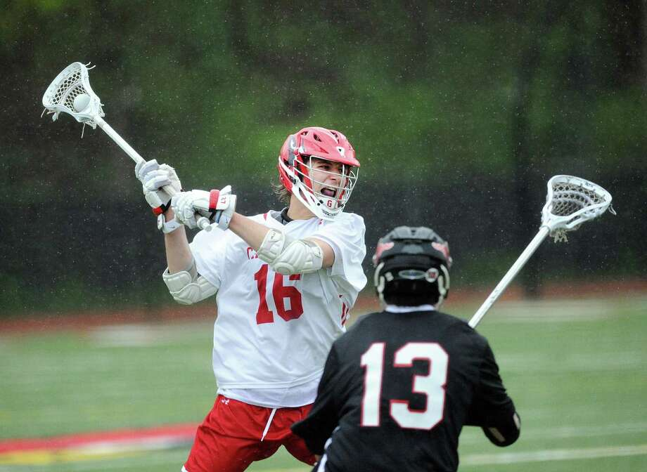 At left, Zach Tucker of Greenwich prepares to unlease a shot on goal as Chris Montenegro (13) of Fairfield Warde defends during the boys high school lacrosse match between Greenwich High School and Fairfield Warde High School at Greenwich, Conn., Tuesday, April 25, 2017. Photo: Bob Luckey Jr. / Hearst Connecticut Media / Greenwich Time