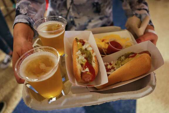 Dollar beers and hot dogs welcome fans to Toyota Center for Game 5 of the Rockets game against the Oklahoma City Thunder, Tuesday, April 24, 2017, in Houston.