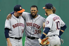 Houston Astros' Teoscar Hernandez (35) grimaces as he puts weight on his leg, during the eighth inning of the Astros' baseball game against the Cleveland Indians, Tuesday, April 25, 2017, in Cleveland. Hernandez collided with Jose Altuve. (AP Photo/Tony Dejak)