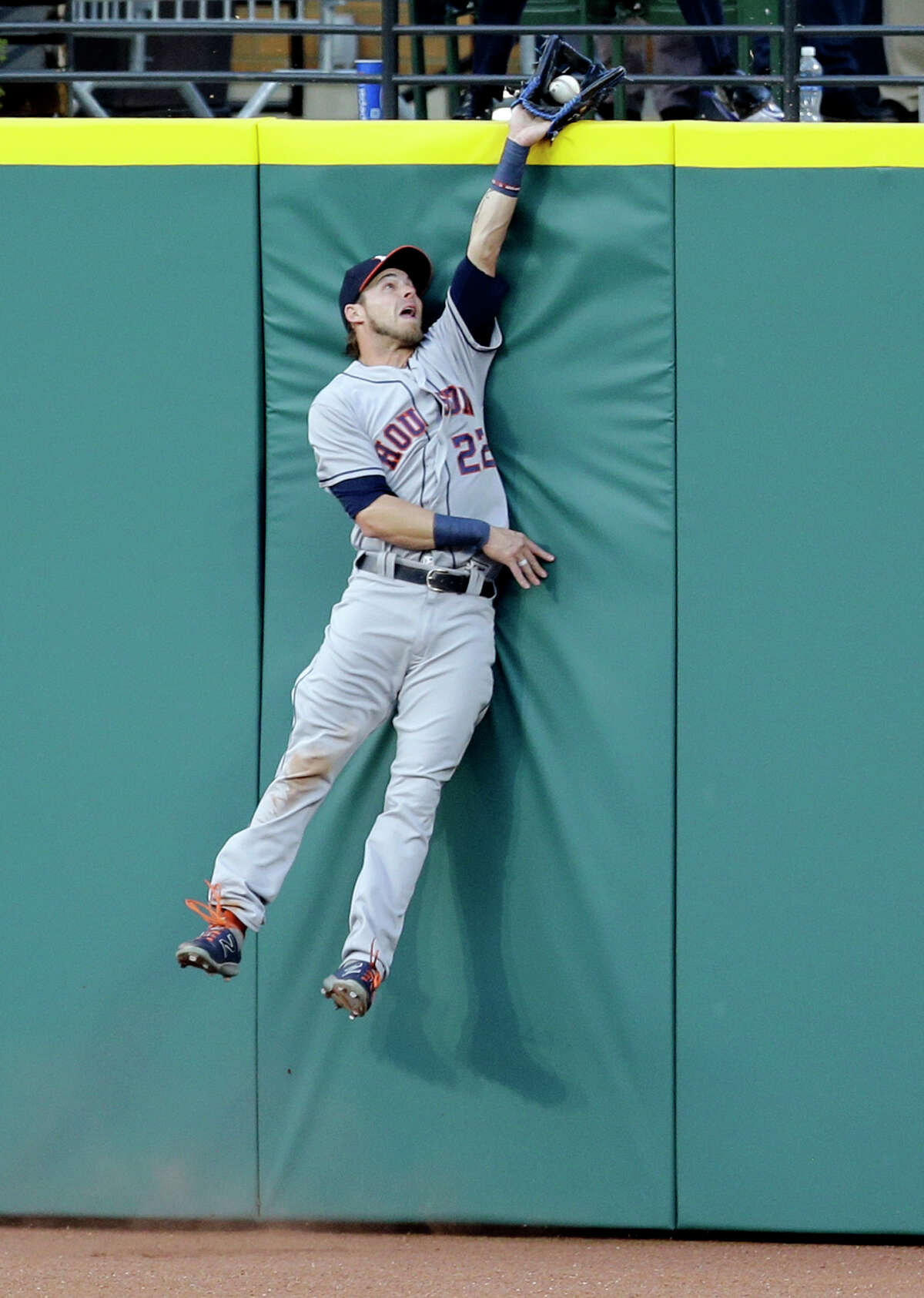 Houston Astros' Josh Reddick reaches for a ball hit by Cleveland Indians' Jason Kipnis in the fifth inning of a baseball game, Tuesday, April 25, 2017, in Cleveland. Kipnis was out on the play. (AP Photo/Tony Dejak)