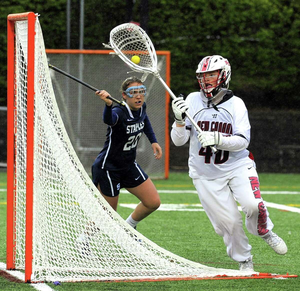 New Canaan goalie Caroline O'Dea looks to pass forward following a save against Staples in a varsity girls lacrosse game at New Canaan High School Dunning Field on Tuesday, April 25, 2017. New Canaan defeated Staples 16-8.