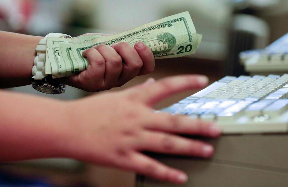 FILE - In this Friday, Nov. 23, 2012, file photo, a cashier rings up a cash sale at a Sears store, in Las Vegas. According to information released Tuesday, April 25, 2017, by the Conference Board, a business research group, U.S. consumer confidence slipped in April but remains at high levels. (AP Photo/Julie Jacobson, File) Photo: Julie Jacobson, STF / Copyright 2017 The Associated Press. All rights reserved.