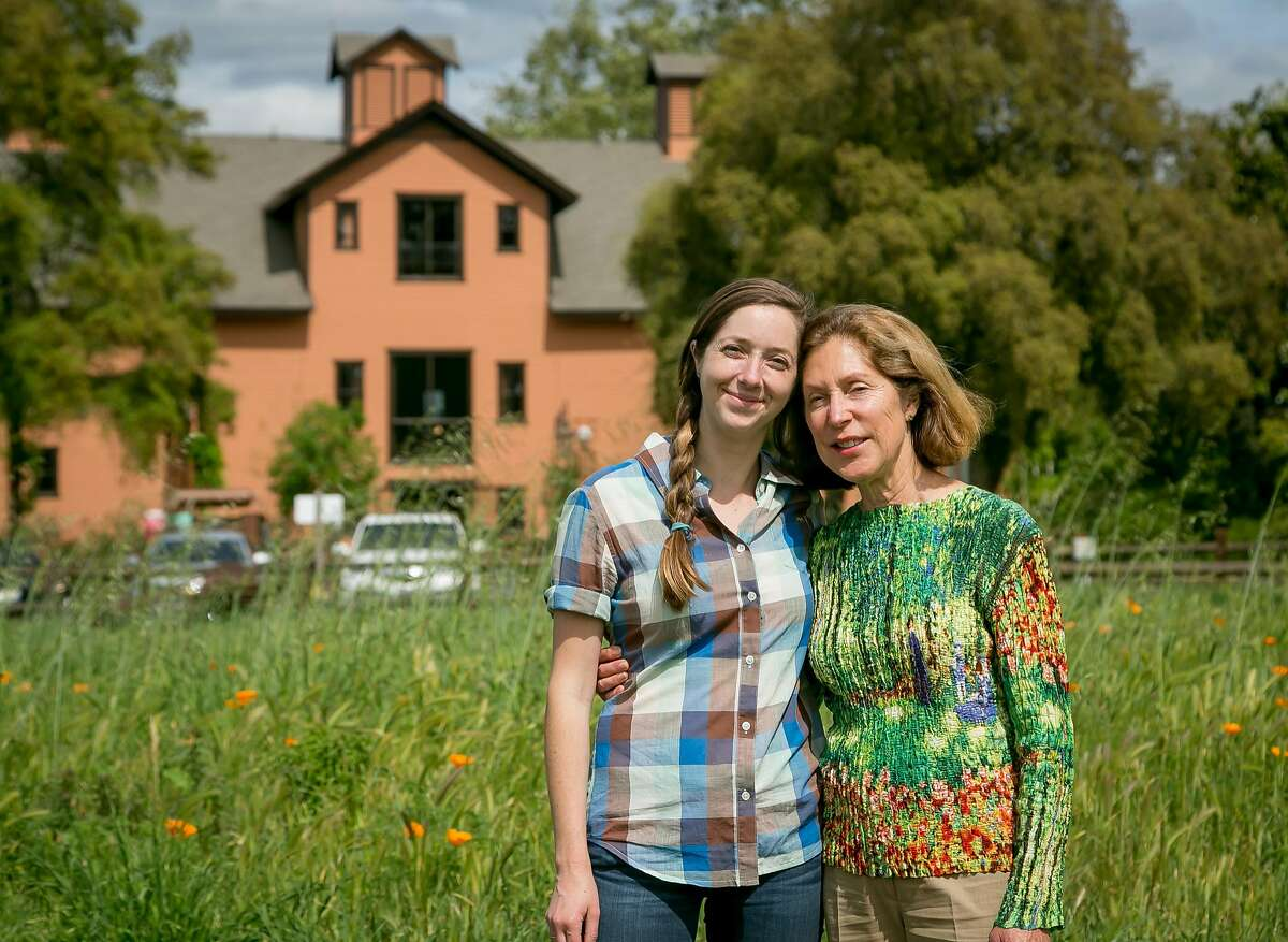 Hailey Trefethen (left) and her mom, Janet Trefethen, at the Trefethen Family Winery with the renovated McIntyre Winery building behind them.