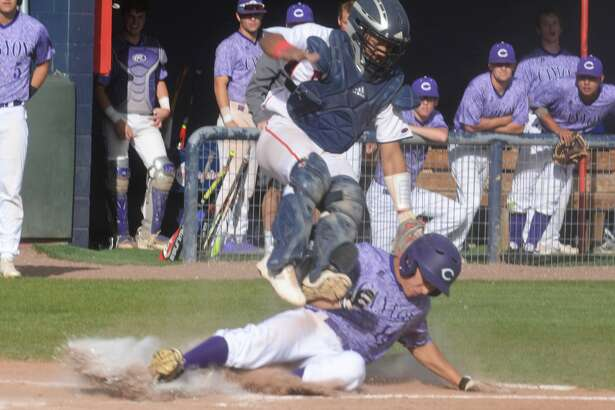 Plainview catcher Gabriel Chavez tags out a sliding Austin Moya of Canyon at home plate to end the fifth inning in a District 3-5A baseball game at Bulldog Park Tuesday.