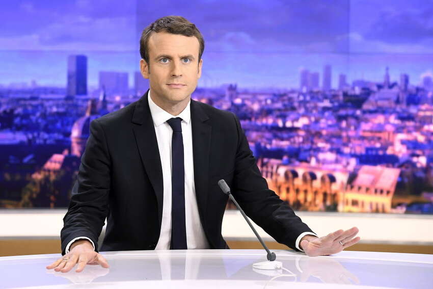 French presidential election candidate for the En Marche ! movement Emmanuel Macron waits before an interview on the set of the French channel France 2 news evening broadcast on April 25, 2017 in Paris. / AFP PHOTO / Lionel BONAVENTURELIONEL BONAVENTURE/AFP/Getty Images