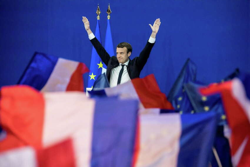 Emmanuel Macron, France's independent presidential candidate, waves while speaking to supporters after the first round of the French presidential election in Paris on April 23, 2017. MUST CREDIT: Bloomberg photo by Christophe Morin.